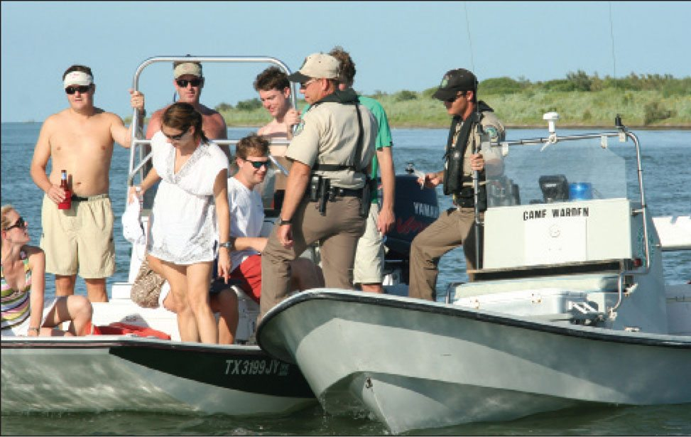 Picture of a ranger discussing safe boating