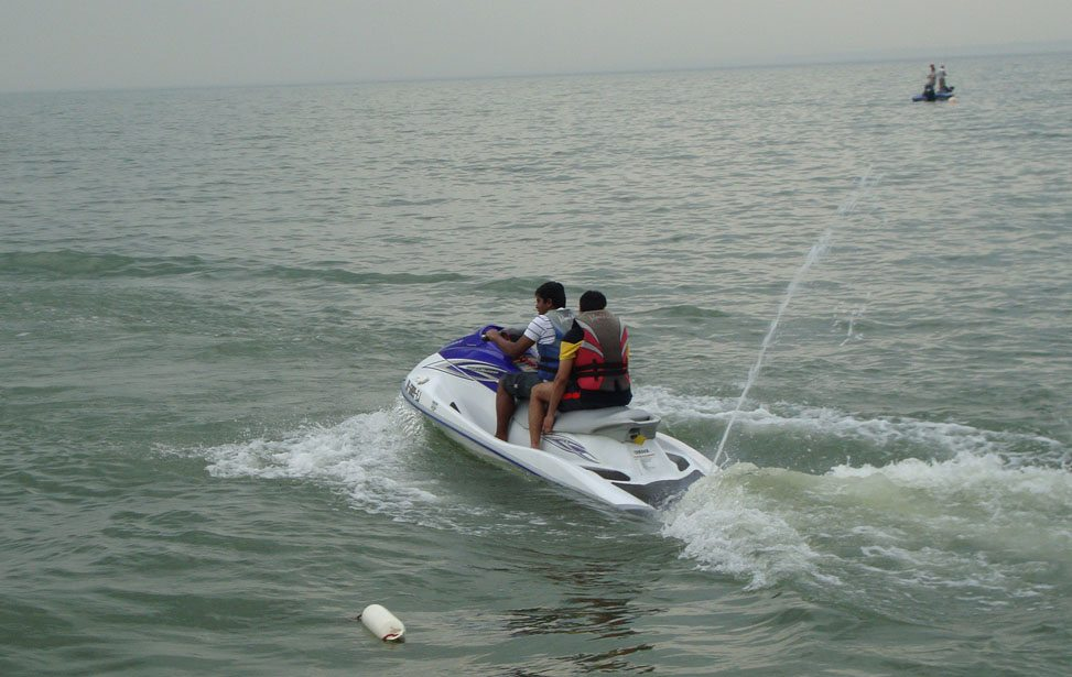 Picture of two people riding Jet Skis & Waverunners